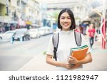 smiling young asian woman with... | Shutterstock . vector #1121982947