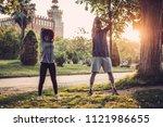 black couple doing exercise... | Shutterstock . vector #1121986655