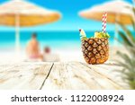 fresh pineapple fruits and... | Shutterstock . vector #1122008924