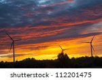 a silhouette of windturbines on ... | Shutterstock . vector #112201475
