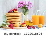 fresh delicious pancakes with... | Shutterstock . vector #1122018605
