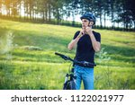 man cyclist is wearing a sports ... | Shutterstock . vector #1122021977