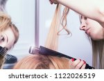 a hairdresser making a haircut | Shutterstock . vector #1122026519
