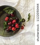 whole red cherries with stems... | Shutterstock . vector #1122050444
