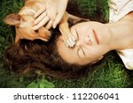 happy woman lying on the grass... | Shutterstock . vector #112206041