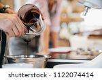 hot  viscous black chocolate... | Shutterstock . vector #1122074414