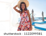 young happy girl with flower... | Shutterstock . vector #1122099581