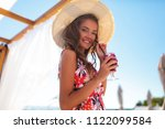 young happy girl with flower... | Shutterstock . vector #1122099584