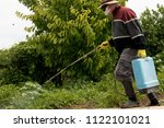 elderly farmer man in hat ...   Shutterstock . vector #1122101021