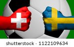Flags of Switzerland and Sweden painted on two clenched fists facing each other with closeup 3d soccer ball in the background/Football match concept