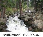 waterfalls in woods | Shutterstock . vector #1122145607