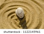 zen meditation stone in sand ... | Shutterstock . vector #1122145961