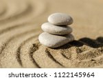 zen meditation stone in sand ... | Shutterstock . vector #1122145964