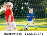 kids play football on outdoor...   Shutterstock . vector #1122187871