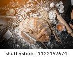 male baker prepares bread. male ... | Shutterstock . vector #1122192674