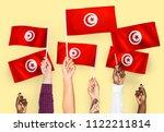 hands waving the flags of... | Shutterstock . vector #1122211814