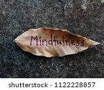 mindfulness written on a dried... | Shutterstock . vector #1122228857