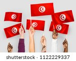 hands waving the flags of... | Shutterstock . vector #1122229337
