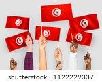 hands waving the flags of... | Shutterstock . vector #1122229337