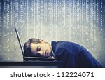 Businessman sleeping on his laptop - stock photo