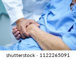 Small photo of Holding Touching hands Asian senior or elderly old lady woman patient with love, care, helping, encourage and empathy at nursing hospital ward : healthy strong medical concept