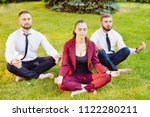 office yoga. three young... | Shutterstock . vector #1122280211