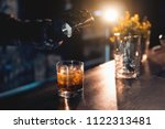 barman preparing luxury drink... | Shutterstock . vector #1122313481