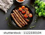 roasted sausages and cherry... | Shutterstock . vector #1122330104