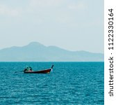 motor boat and island in the sea | Shutterstock . vector #1122330164