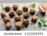 meatballs on black stone board. ... | Shutterstock . vector #1122332951