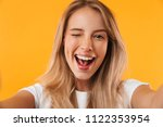 cheerful young blonde girl...   Shutterstock . vector #1122353954