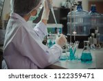 asian women scientist with test ... | Shutterstock . vector #1122359471