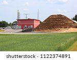 halde with biomass of a biogas... | Shutterstock . vector #1122374891