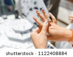 a woman trying on her new ring... | Shutterstock . vector #1122408884