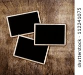 blank photo frames on aged wall   Shutterstock . vector #112241075