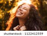 portrait closeup of happy curly ... | Shutterstock . vector #1122412559