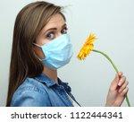 woman wearing medical mask...   Shutterstock . vector #1122444341