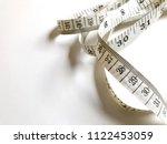 measurement tape on white... | Shutterstock . vector #1122453059
