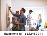 young developers are... | Shutterstock . vector #1122453344