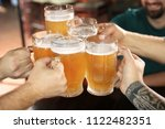 friends clinking glasses with... | Shutterstock . vector #1122482351