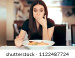 woman feeling sick while eating ... | Shutterstock . vector #1122487724