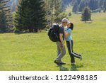 sporty woman hugging man with... | Shutterstock . vector #1122498185