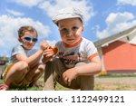 boy in cap with bun sitting... | Shutterstock . vector #1122499121