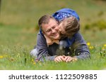 girl laying on father and... | Shutterstock . vector #1122509885