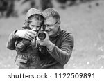 father teaching daughter how to ... | Shutterstock . vector #1122509891