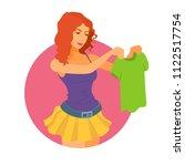 a girl holds a t shirt in hands ...   Shutterstock .eps vector #1122517754