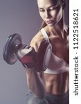 fitness young woman with heavy... | Shutterstock . vector #1122518621