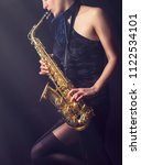 saxophone player. woman with... | Shutterstock . vector #1122534101