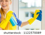 young woman in yellow gloves... | Shutterstock . vector #1122570089