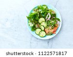 mixed leaf salad with smoked... | Shutterstock . vector #1122571817